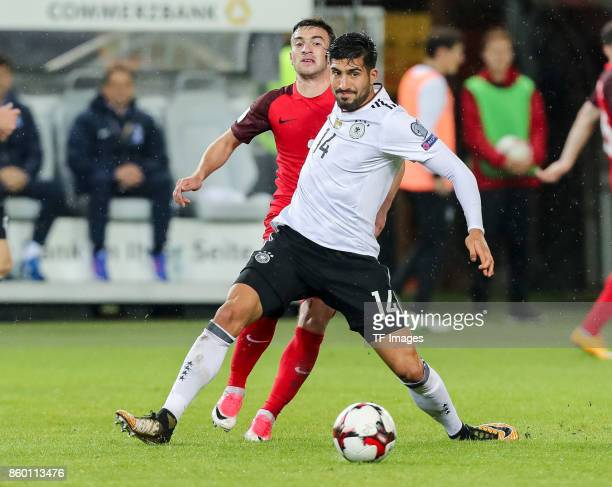Gara Garayev of Azerbaijan und Emre Can of Germany battle for the ball during the FIFA 2018 World Cup Qualifier between Germany and Azerbaijan at...