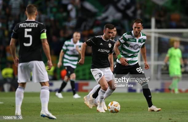 Gara Garayev of Qarabag FK with Nemanja Gudelj of Sporting CP in action during the UEFA Europa League Group E match between Sporting CP and Qarabag...