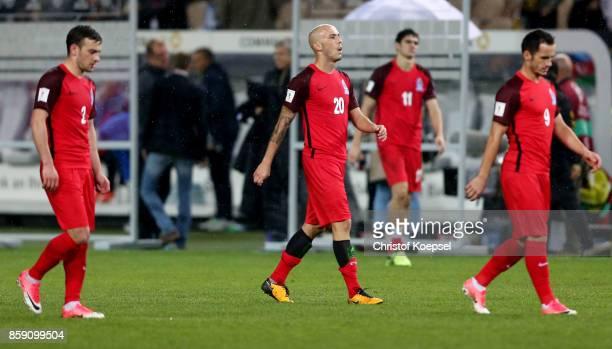 Gara Garayev Richard Almeida and Amik Alaskarov of Azerbaijan look dejected after losing 15 the FIFA 2018 World Cup Qualifier between Germany and...