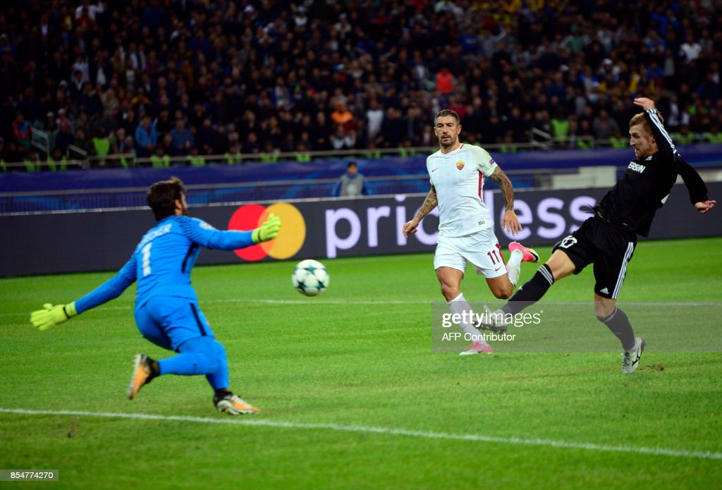 Garabagh's midfielder from Brazil Pedro Henrique (R) shoots to score during the UEFA Champions League Group C football match between Qarabag FK and AS Roma in Baku on September 27, 2017. /