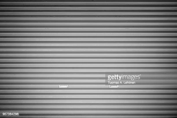 garage door background - roller shutter stock pictures, royalty-free photos & images
