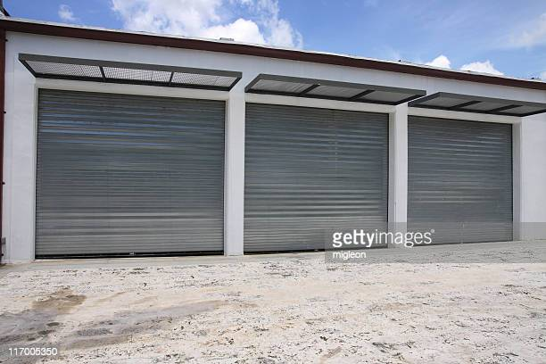 garage doors - auto repair shop exterior stock pictures, royalty-free photos & images