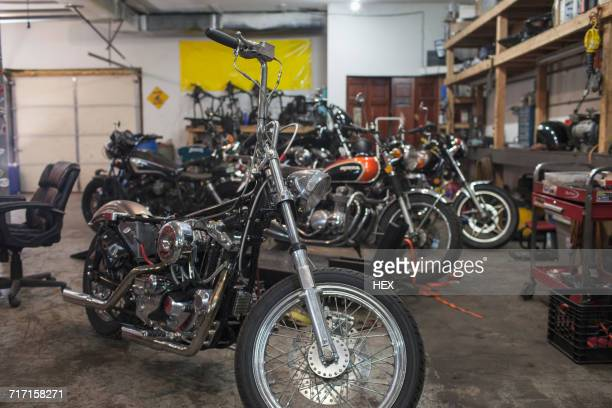 A garage full of motocycles.