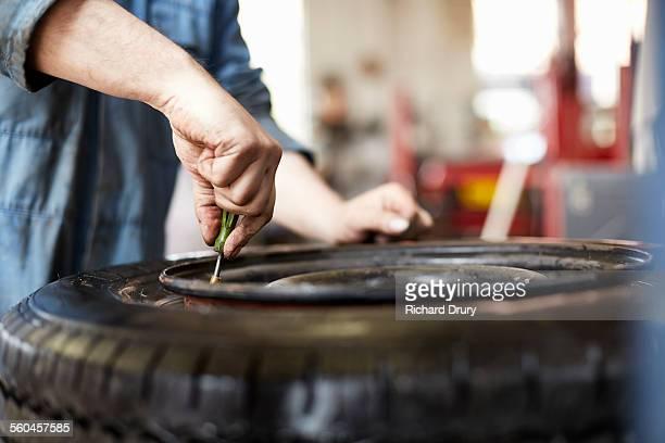 Garage mechanic changing valve