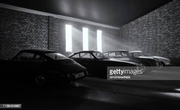 garage of dream car (models) - porsche 911 stock-fotos und bilder