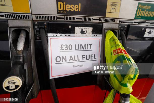 Garage owner's sign notifying customers of a £30 limit to their fuel purchases is displayed at a Texaco franchise garage on September 24, 2021 in...