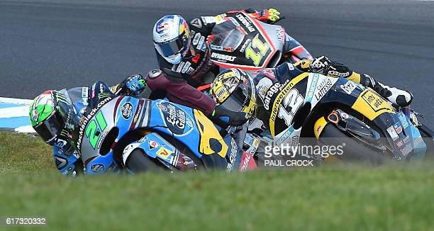 Garage Plus Interwetten Kalex rider Thomas Luthi of Switerland races against Marc VDS rider Franco Morbidelli of Italy and Dynavolt Intact GP rider...
