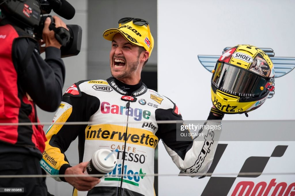 TOPSHOT - Garage Plus Interwetten's Swiss rider Thomas Luthi celebrates on the podium after winning the Moto2 race at the motorcycling British Grand Prix at Silverstone circuit in Northamptonshire, southern England, on September 4, 2016. /