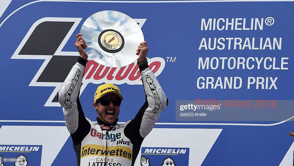 Garage Plus Interwetten's Thomas Luthi of Switzerland celebrates on the podium after the Australian Moto2 race at Phillip Island on October 23, 2016. / AFP / SAEED