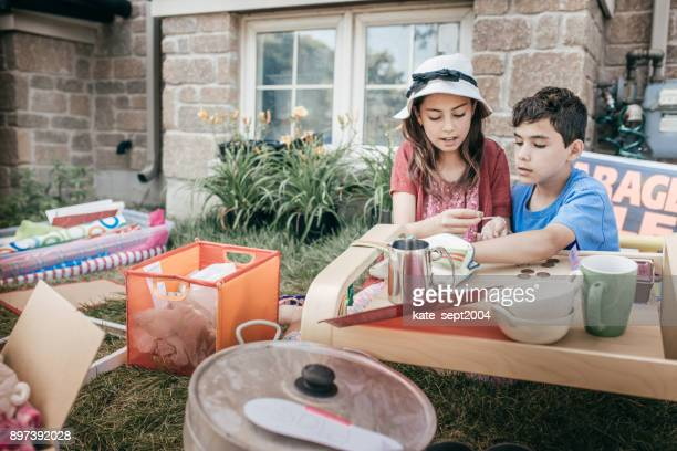 garage sale  and kids - garage sale stock pictures, royalty-free photos & images