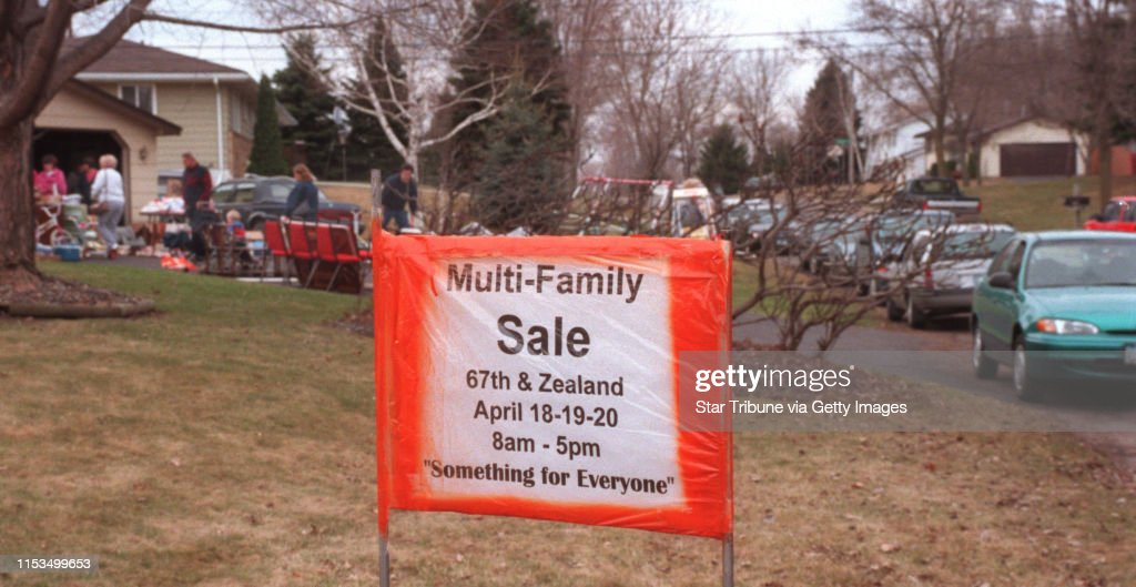 Garage sale basics -- Cars filled the street near this sign that