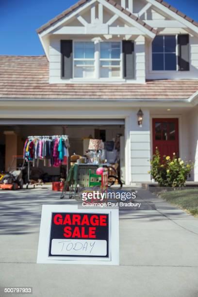 Garage Sale sign in driveway
