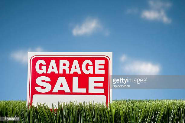 garage sale sign in grass against blue sky - garage sale stock pictures, royalty-free photos & images