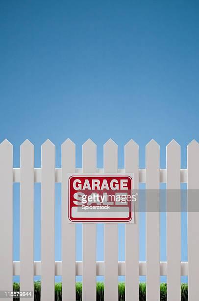 Garage Sale Sign On White Picket Fence