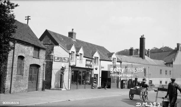 Garage, South Street, Sherborne, Dorset, 1939. Sheppard's Garage apparently had both Shell and Esso petrol pumps. The garage has since been converted...