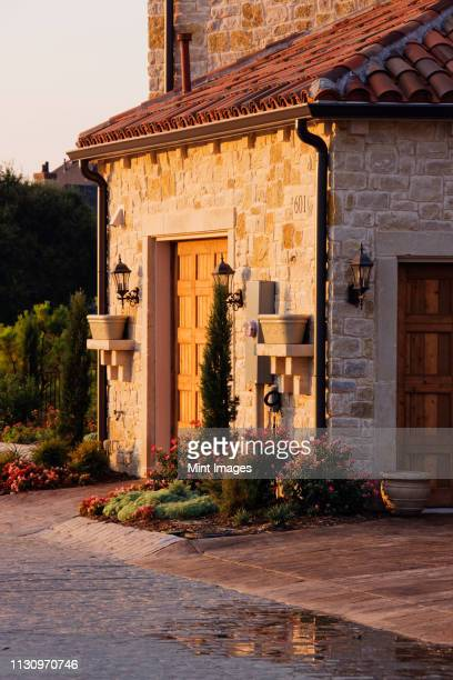 garage space - stone house stock pictures, royalty-free photos & images
