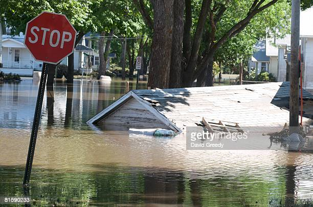 Garage that floated down a street is still submerged in floodwater June 16, 2008 in Cedar Rapids, Iowa. Officials are conducting door to door home...