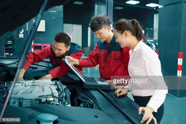 garage worker and client - electric motor stock photos and pictures