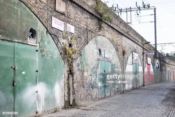 garages under railway arches in east london - east london stock pictures, royalty-free photos & images