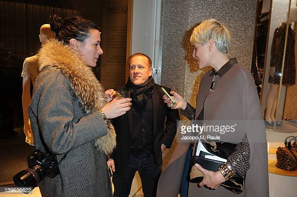 Garance Dore Scott Shuman and Elisa Nalin attend the Valentino Flagship Store Opening during Milan Womenswear Fashion Week on February 23 2012 in...