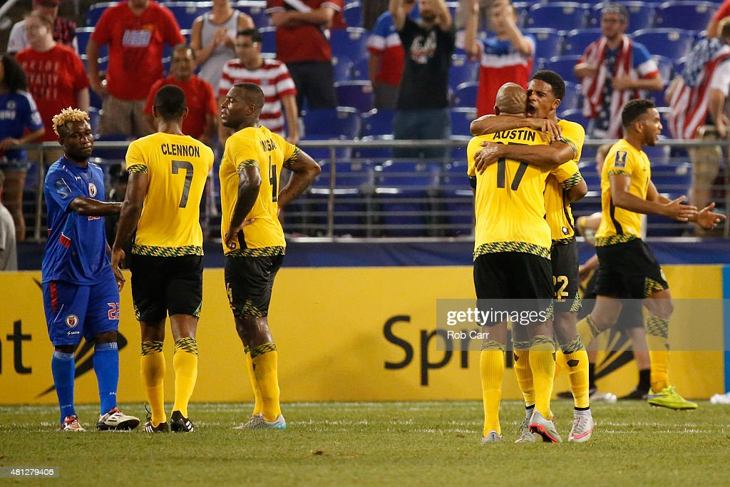 Garath McCleary #22 hugs teammate Rodolph Austin #17 of Jamaica following their 1-0 win over Haiti during the 2015 CONCACAF Gold Cup quarterfinal match at M&T Bank Stadium on July 18, 2015 in Baltimore, Maryland.