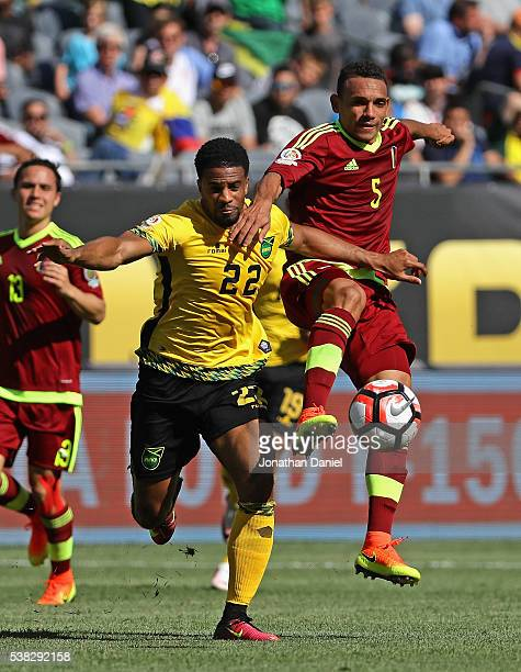 Garath McCleary of Jamaica and Arquimedes Figuera of Venezuela battle for the ball during a match in the 2016 Copa America Centenario at Soldier...