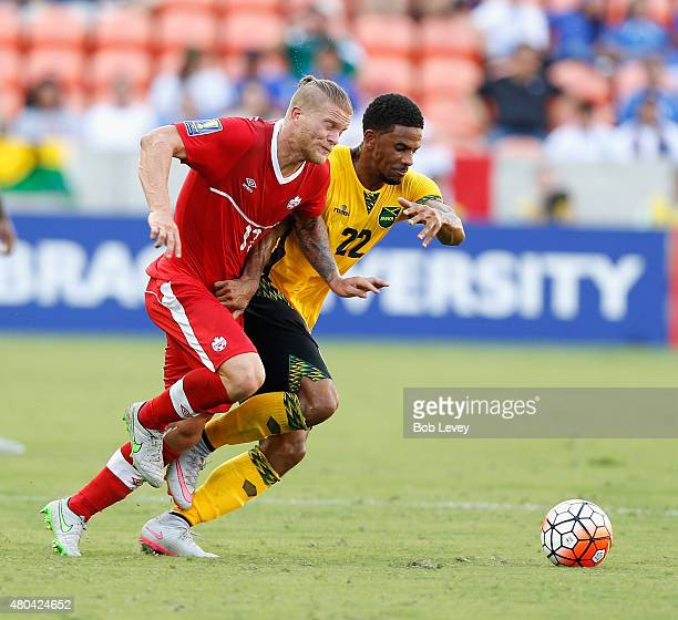 Garath McCleary of Jamaica and Marcel de Jong of Canada fight for possession of the ball in the first half at BBVA Compass Stadium on July 11 2015 in...