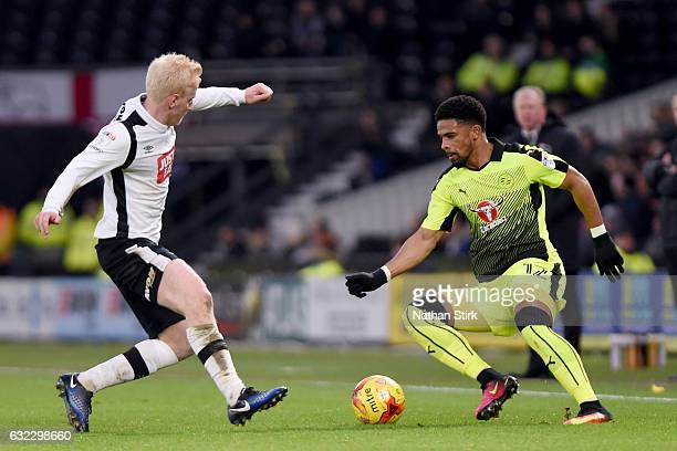 Garath McCleary of Reading and Will Hughes of Derby in action during the Sky Bet Championship match between Derby County and Reading at the iPro...