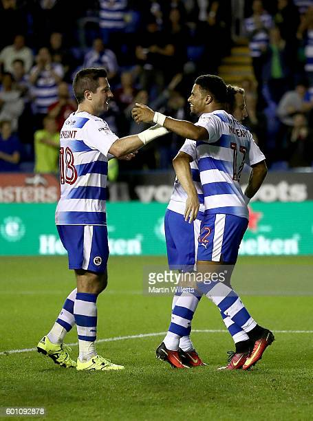 Garath McCleary of Reading celebrates with teammates after scoring the opening goal from a penalty during the Sky Bet Championship match between...