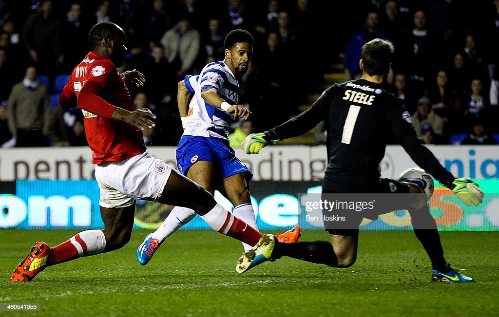 Garath McCleary of Reading shoots on goal during the Sky Bet Championship match between Reading and Barnsley at Madejski Stadium on March 25, 2014 in Reading, England,