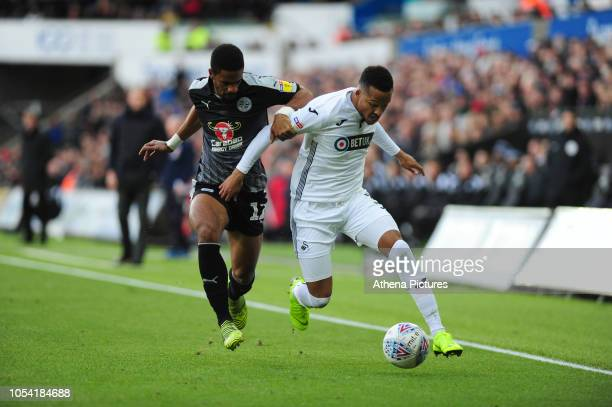 Garath McCleary of Reading vies for possession with Martin Olsson of Swansea City during the Sky Bet Championship match between Swansea City and...