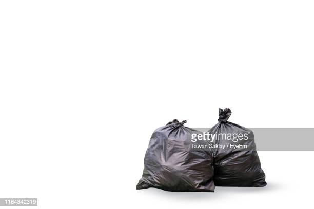 garbage bags against white background - bin bag stock pictures, royalty-free photos & images