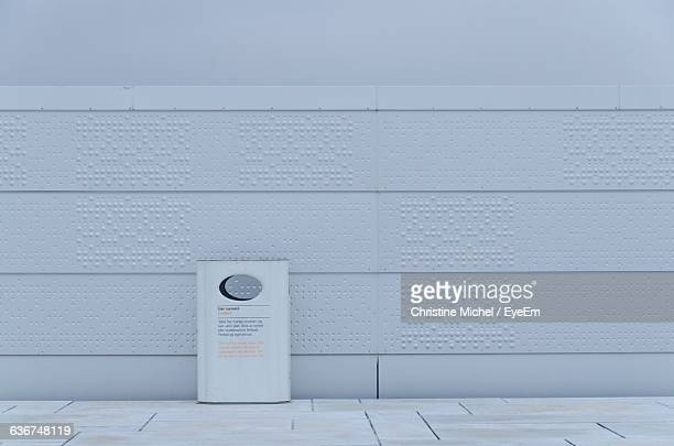 Garbage Bin Against White Wall