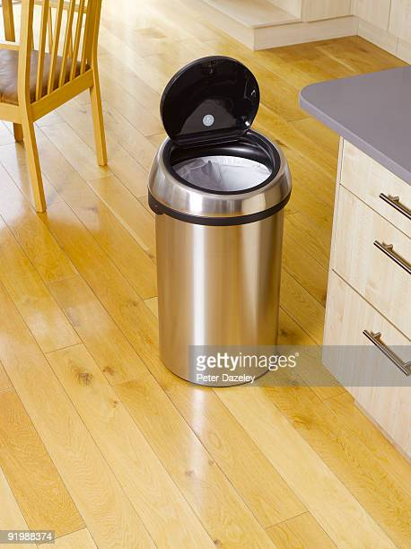 garbage bin in kitchen setting. - bin stock pictures, royalty-free photos & images