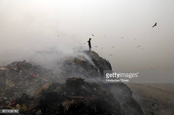 Garbage burning adding pollution to environment at Bhalswa Landfill as smog covers the capital's skyline on November 6 2016 in New Delhi India New...