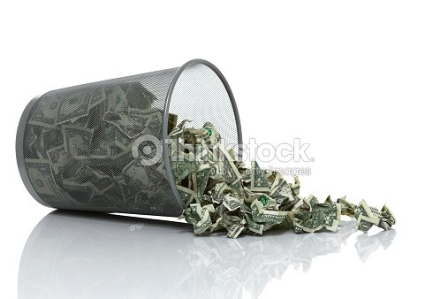 Garbage Can Full Of Money Tipped On Side Spilling Stock Photo