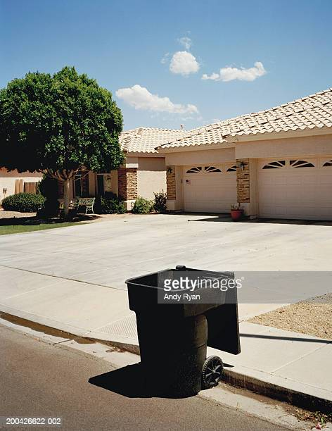 garbage can in front of house, close-up - garbage can stock pictures, royalty-free photos & images