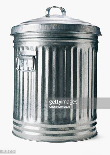 a garbage can on a white background. - garbage can stock photos and pictures
