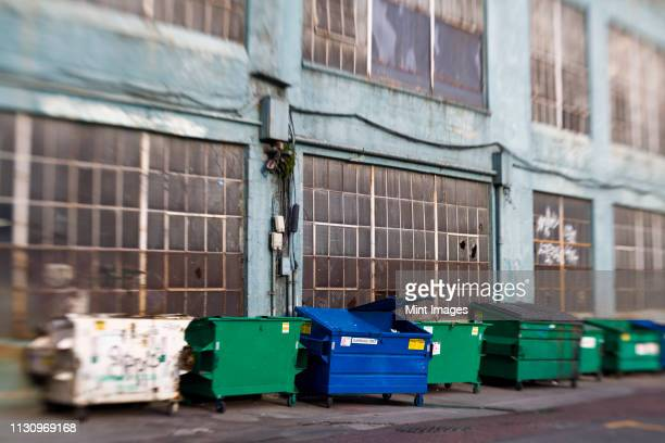 garbage canisters in alley, seattle, washington - waste management stock pictures, royalty-free photos & images