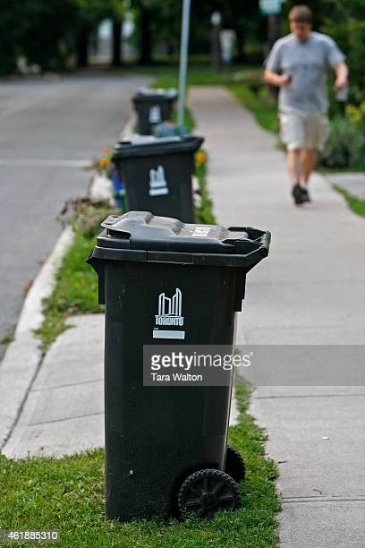 Garbage cans line the curb of Humewood Drive Monday evening for the first time in since June 22 when the Toronto garbage strike started Normal...