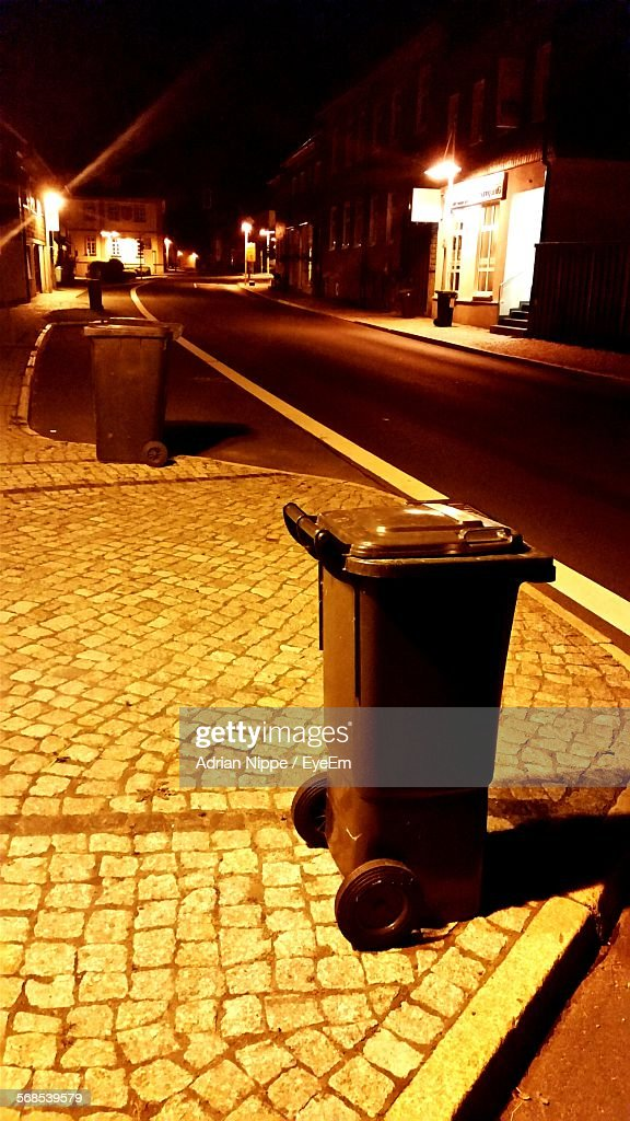 Garbage Cans On Sidewalk At Night : Stock Photo