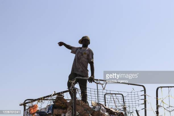 Garbage collector carries recycled materials from a dump site to earn his family's keep in Tripoli, Libya on September 10, 2020. Garbages collected...