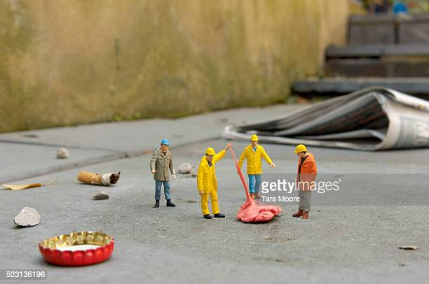 Garbage Collector Figurines Picking Up Litter