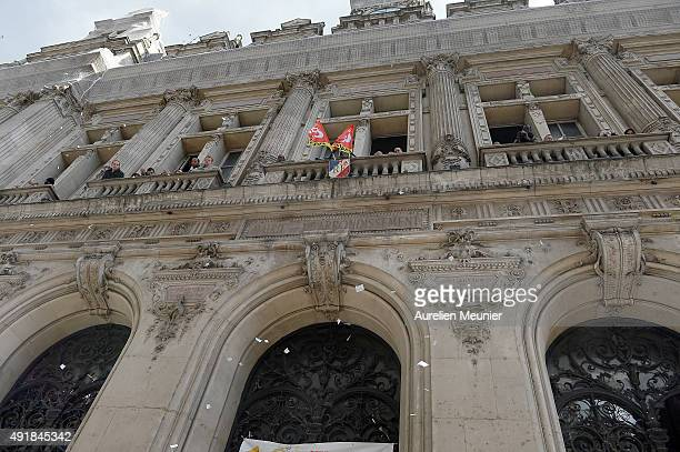 Garbage collectors occupy the City Hall of the 10th district of Paris and throwing papers by the windows during their strike over pay and cost cuts...