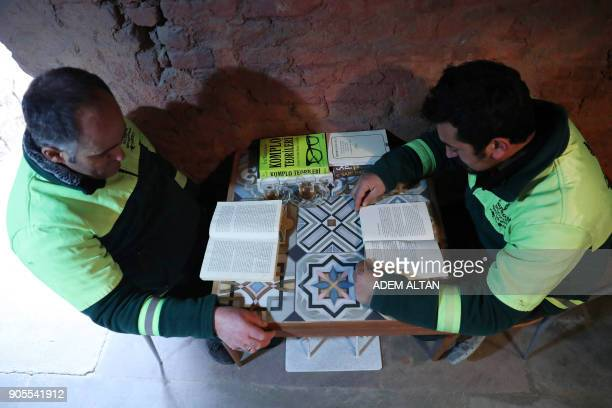 Garbage collectors read books in a library created by the municipal employees by collecting thrownout books at the Cankaya district of Ankara on...