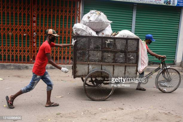 Garbage collectors wearing face masks collect trashes from every home in the city The cleaners of this city are also taking risk every moment during...