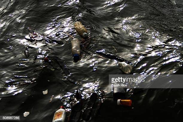 Garbage floats in the Flint River on February 7 2016 in Flint Michigan Months ago the city told citizens they could use tap water if they boiled it...