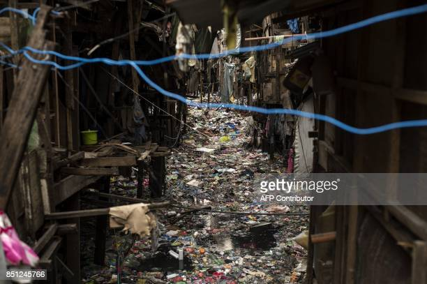 Garbage floats on a creek in Manila on September 22 2017 Giant Western consumer products brands led by Nestle Unilever and Procter Gamble cause...