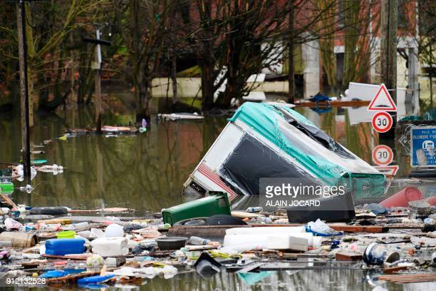 Garbage floats on a flooded street on January 30 in VilleneuveleRoi near Paris The River Seine peaked on January 29 2018 at more than four metres...