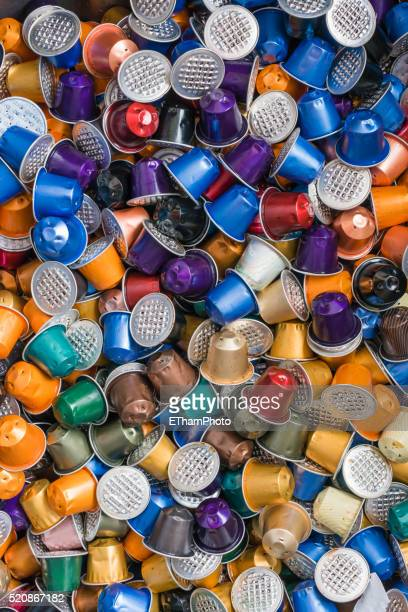 Garbage heap of colourful empty Nespresso disposable espresso capsules